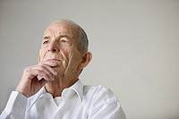 Close up of elderly man thinking