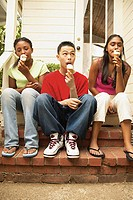 Three teenagers eating ice cream cones