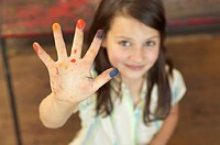 Little girl shows paint on her hands