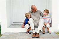 Grandfather sitting with grandsons