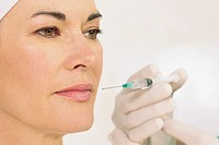 Woman receiving a collagen injection