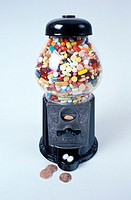 Assorted tablets and capsules in a gumball machine