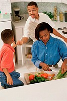 Parents in the kitchen with their son