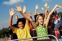 Group of teenagers riding a rollercoaster