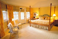 Hawaii, Lanai, The Lodge at Koele, interior of suite with golden lighting, windows open