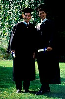 Portrait of two male graduates smiling