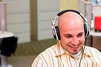 Close-up of a businessman wearing headphones in an office