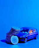 Pile of UAE coins and toy car (thumbnail)