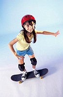 Portrait of a girl riding a skateboard