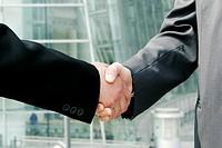 A handshake between two businessmen.