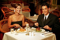 A couple having dinner in a restaurant.