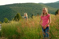 a girl in a grassland.