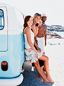 Four people in Summer Outfits Leaning Against a Camping Van