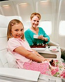 Mother and Daughter Sitting in an Aircraft Cabin