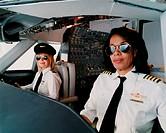 Portrait of Female Pilots Sitting at the Cockpit