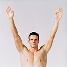 Naked Man With His Arms Upstretched