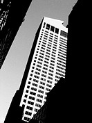 An office tower in mid-town Manhattan is captured in Black and White, then later blurred in Photoshop. The Tower has a slight lean to it, but still ma...