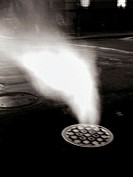Steam pouring from a Manhole cover on New York's Lower Eastside is caputed at night in a 2second time exposure. The resulting photo is ghostly and omi...