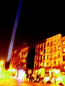 Ground Zero's freedom lights can be scene shining over 1st Avenue in New York's East Village.  Long time exposure blurs the buildings, giving the scen...