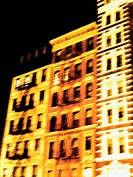 Three old tenement buildings in New York's East Village.  Slightly blurred, they have a ghostly, other worldly feel. More like a painting than a photo...