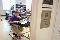Students working on laptop computers can access the school's network wirelessly so they can send and receive assignments via email