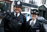 policemen at portobello road, london notting hill, great britain