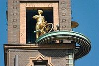 Weather indicator above Nordea Bank in Vesterbrogade. Lady on bike indicating good weather, Copenhagen, Denmark
