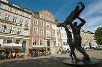 Modern sculpture group on Gammel Strand. Cafes background, Copenhagen, Denmark
