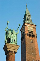 Statue of lure players in Town Hall Square. Town Hall tower behind, Copenhagen, Denmark