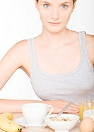 Young woman with large breakfast