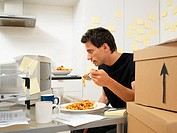Man working and eating dinner