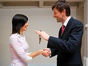 Man and woman exchanging keys