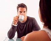 Man having coffee with woman