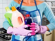 Woman holding cleaning products