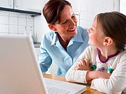 Mother and daughter with laptop computer