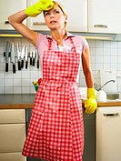 Woman standing by sink