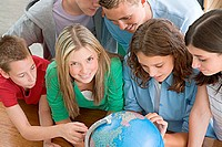 School students with a globe