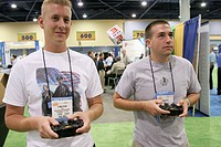 Teens play virtual video game. IACP Annual Conference, Convention Center, Miami Beach, Florida. USA.