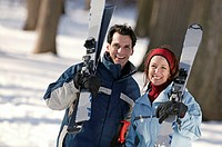 Couple skiing, portrait.