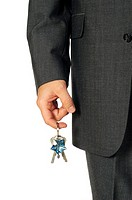 Mid section view of a businessman holding keys (thumbnail)