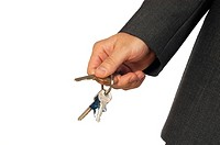 Mid section view of a businessman holding keys