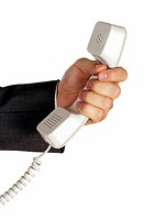 Close-up of a businessman holding a telephone receiver