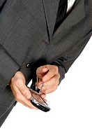 Mid section view of a businessman using a personal data assistant