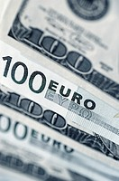 Euro 100 bank notes and United States one hundred dollar bills, close-up