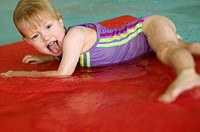3 year old Caucasian girl swimming