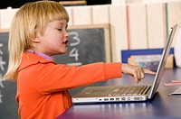 4 year old Caucasian girl and laptop
