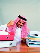 Arab businessman being angry at his desk (thumbnail)