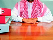 Arab Businessman doing nothing at his desk