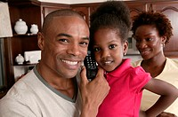 Father and daughter on telephone, portrait.