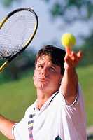 Man serving in tennis